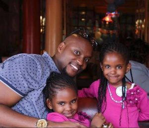 Paul Ndichu and his twins with grace Msalame